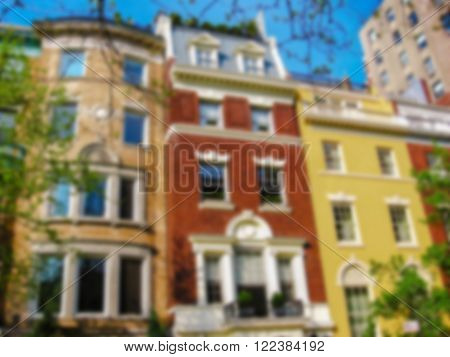 Defocused background of historical colorful building facade in Lower East Side, New York City, United States. Intentionally blurred post production for bokeh effect.