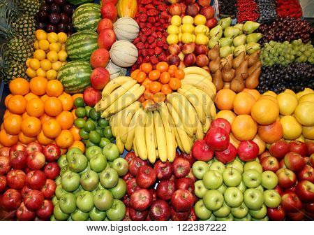 Close Up Of Many Colorful Fruits On Market Stand