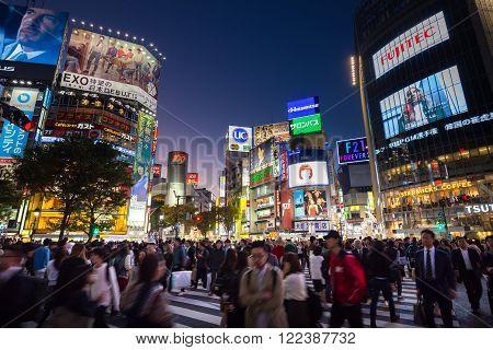 Tokyo, Japan - Nov 6: Pedestrians cross at Shibuya Crossing on November 6th in Tokyo, Japan, 2015 . Shibuya Crossing is one of the busiest crosswalks in the world.