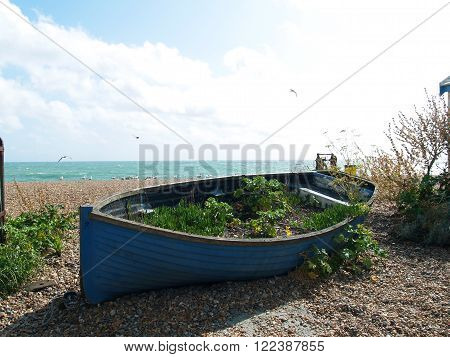 Old unusable boat on the beach in Brighton