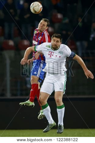 BUDAPEST HUNGARY - MARCH 19 2016: Air battle between Zsolt Korcsmar of Vasas (l) and Daniel Bode of Ferencvaros during Vasas - Ferencvaros OTP Bank League football match at Illovszky Stadium.