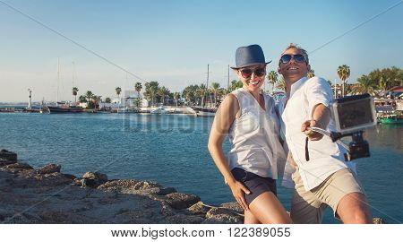 Happy couple take a vacation photo in sea bay
