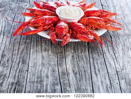 Boiled red crayfish on an old wooden table