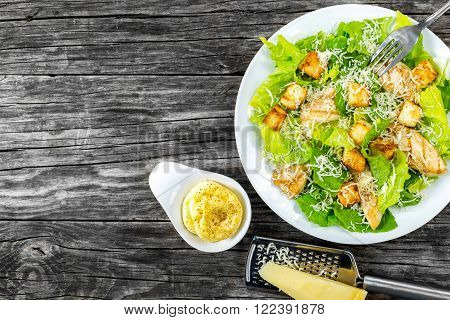 salad with croutons grilled chicken breast grated parmesan cheese