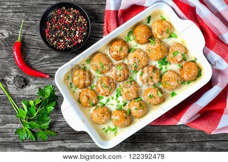 Swedish homemade meatballs smothered in a creamy gravy sauce close-up