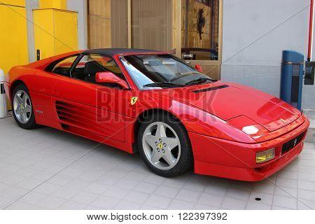 La Condamine Monaco - March 17 2016: Red Ferrari 348 TS For Sale Parked in Front of a Ferrari Car Dealer in Monaco