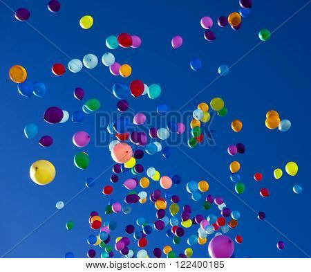 colorful balloons on a blue sky background ** Note: Visible grain at 100%, best at smaller sizes
