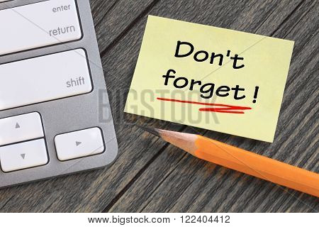 message of don't forget written on a note