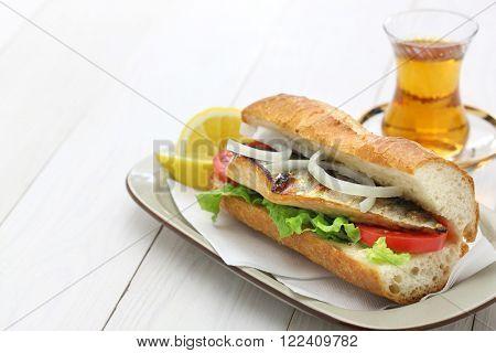 mackerel fish sandwich and a glass of tea,turkish food
