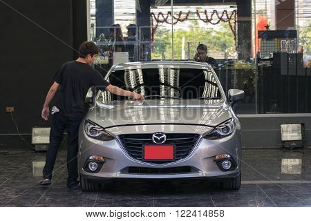 Bangkok, Thailand - May 5, 2016 : Unidentified car care staff cleaning the car (Car detailing).