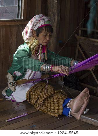 INLE LAKE, MYANMAR - JANUARY 12, 2016: Padaung Tribal woman poses for a photo in Inle lake, Myanmar, Burma The Padaung-Karen long-necked tribe women are minority of Myanmar.