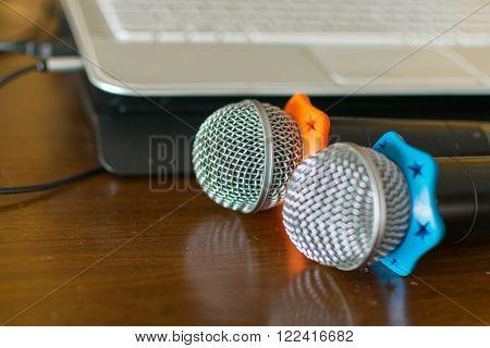 Microphone in seminar event defocus on computer laptop background
