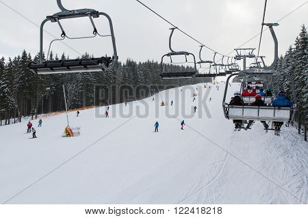 Bukovel, Ukraine - February 25, 2016:  Skiers and snowboarders enjoying on slopes of ski resort Bukovel, Ukraine.