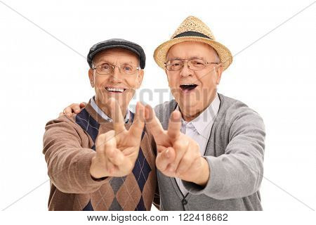 Two joyful senior gentlemen making peace sign with their hands isolated on white background