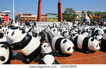 BANGKOKTHAILAND - MARCH 14 2016 : 1600 Pandas+ TH Paper mache Pandas to represent 1600 Pandas and to raise awareness in conservation and sustainable development for endangered animals in Thailand.