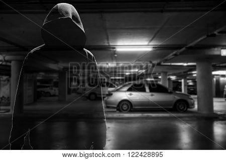 Car thief at parking lot ( criminal concept )