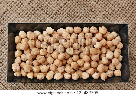 Chickpeas In Black Plate On The Gunny Cloth