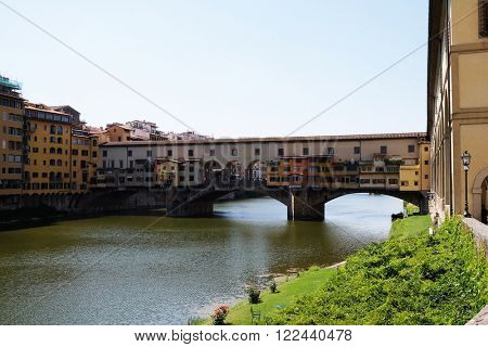 FLORENCE, ITALY - JUNE 05: View of medieval stone bridge Ponte Vecchio and the Arno Rive in Florence, Tuscany, Italy, on June 05, 2015