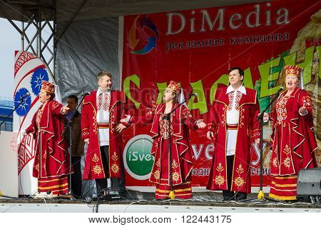 GOMEL BELARUS - MARCH 12 2016: Speech by creative choral collective during Shrovetide celebrations Gomel Belarus