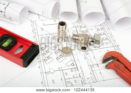 Architecture plan and rolls of blueprints with turn-screw. Building concept