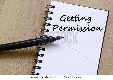 Getting permission text concept write on notebook with pen poster