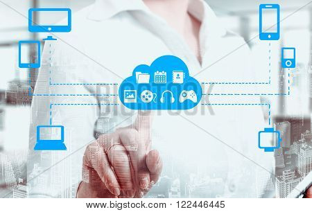 Businesswomen touching a cloud connected to many objects on a virtual screen concept about internet of things.