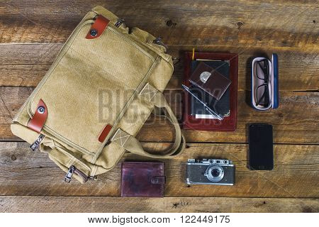 bag with contents to travel on the background of the old board