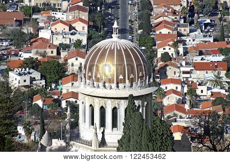 HAIFA ISRAEL - MARCH 01 2016: Bahai temple on background of the HAIFA ISRAEL - MARCH 01 2016: Bahai temple on background of the German quarter