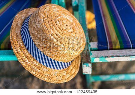 Woven hat on the beach chair at Bangsaen Beach Thailand poster