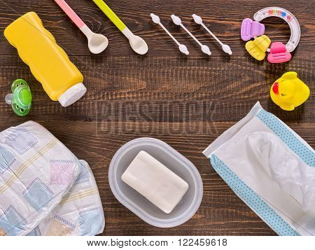 Baby Essentials And Care On Dark Wooden Table With Copy Space
