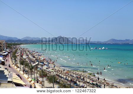 Mallorca Spain - June 29 2015: The tourists enjoiying their vacation on the beach. Up to 60 mln tourists is expected to visit Spain in year 2015.