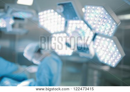 Surgery in hospital operation room. Unfocused background.