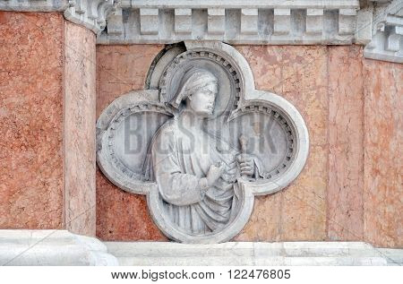 BOLOGNA, ITALY - JUNE 04: Saint Florian by Paolo di Bonaiuto relief on facade of the San Petronio Basilica in Bologna, Italy, on June 04, 2015