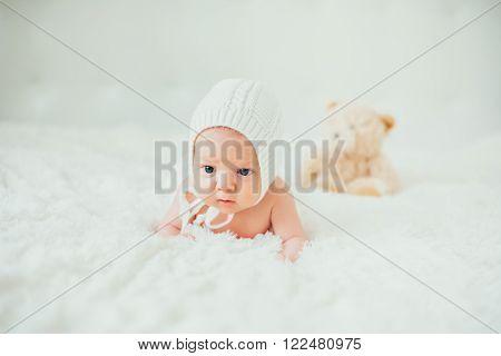 strange funny portrait dreamy little baby (child kidd infant) lying in a carpet. newborn. son. boy.