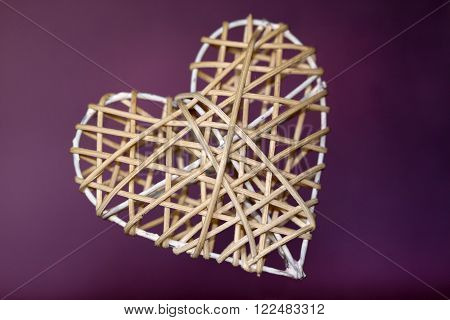 Close up  of designer heart with purple background ** Note: Soft Focus at 100%, best at smaller sizes