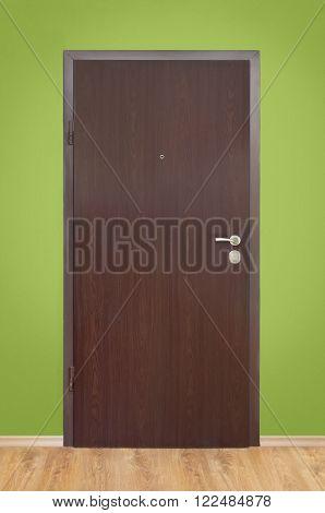 interior wooden door on green wall background