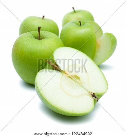 Green golden delicious apples whole and sliced isolated over white