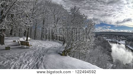 Snow covered forest landscape and Verkiai palace viewpoint.