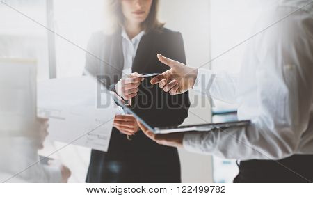 Photo business partners meeting. Team job. Business woman giving card colleague. Presentation new project modern office.