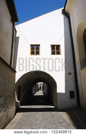 KOSICE SLOVAKIA -MAY 01 2014: Old arch and small street in historical center of Kosice city Slovakia.