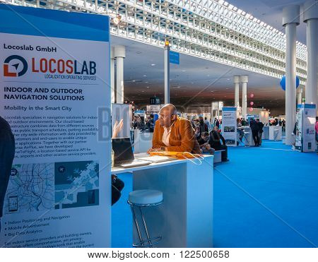 HANNOVER GERMANY - MARCH 14 2016: Attendee visits stand of Locoslab company at CeBIT information technology trade show in Hannover Germany on March 14 2016.