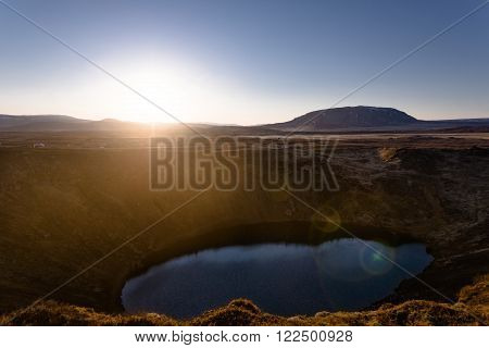 Kerid volcanic crater lake in Iceland at sunset poster