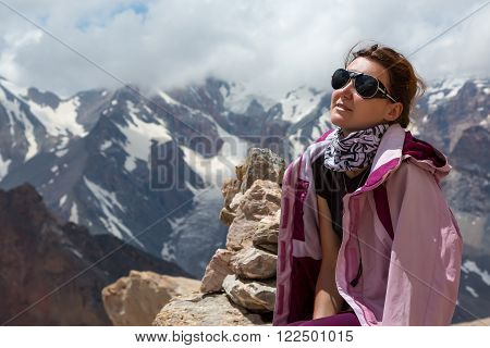 Portrait of Smiling Woman Sporty Style Clothing Outwear Sunglasses Sunny Mountain Landscape