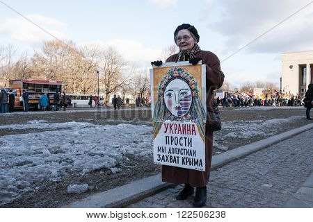 Saint-Petersburg Russia - March 18 2016: the rally on the occasion of the second anniversary of the reunion of Crimea to Russia Pickets against the annexation of Crimea to Russia.