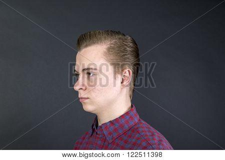 Unhappy Sixteen Year Old Boy In Studio