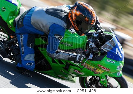 BROADFORD, VICTORIA/AUSTRALIA - MARCH 20, 2016: A mix of bikes and sidecars tussle against each other at Round 1 of the Interclub Series at The Broadford Motorcycle Complex near Melbourne.