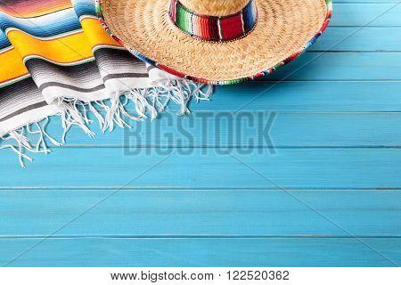 Mexico, Mexican sombrero and traditional serape blanket background, cinco de mayo concept