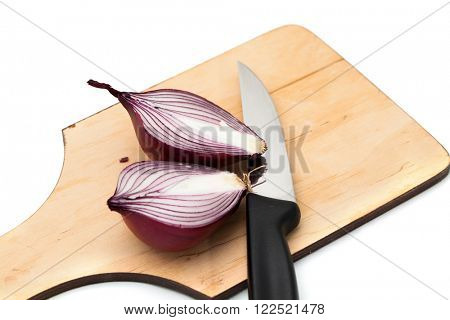 Onions cut into pieces on a board on a white background