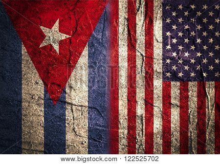 Image relative to politic relationships between USA and Cuba. USA and cuban grunge Flag. Concrete textured