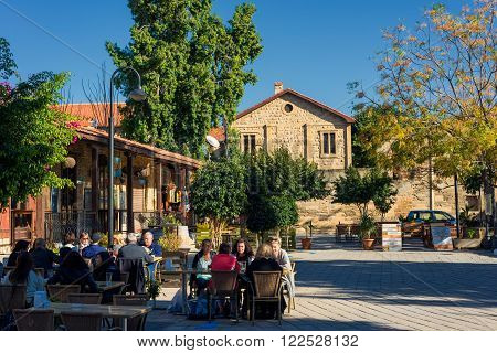 NICOSIA, CYPRUS - DECEMBER 3: People enjoying a summer in cafes at Selimiye square on December 3, 2015 in Nicosia.